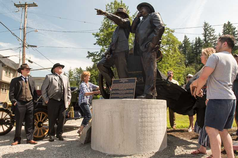 OUTLOOK PHOTO: JOSH KULLA - Devoted Passion, Troutdale sculptor Rip Caswells latest creation, is unveiled Tuesday at a ceremony held to celebrate the 100th anniversary of the Historic Columbia River Highway.