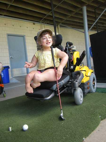 Bryten Hoffman is one of the children who enjoys playing golf with MIGA.