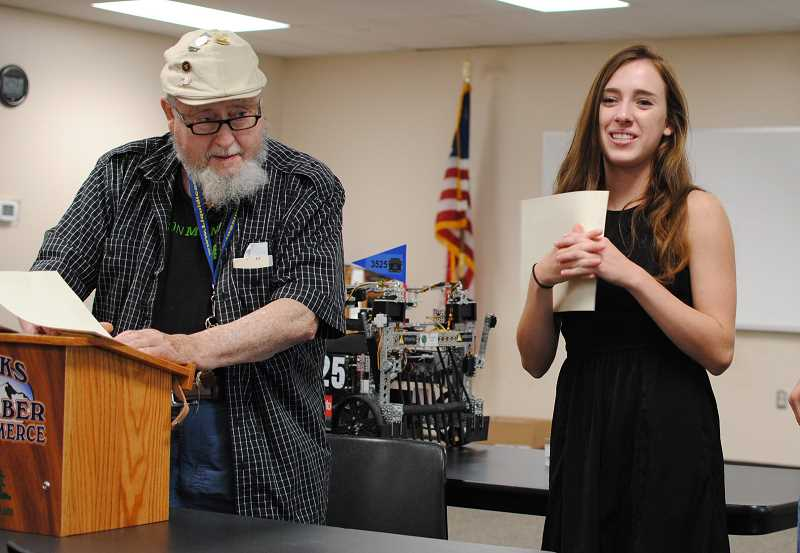 NEWS-TIMES PHOTOS: STEPHANIE HAUGEN - Jamie Borchers received her scholarship award last week from Banks Chamber of Commerce President Ray Deeth.