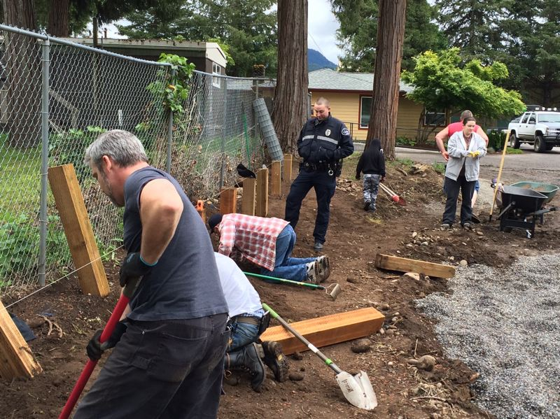 PHOTO COURTESY ST. VINCENT DE PAUL OF LANE COUNTY - Volunteers from the city of Oakridge fire department and city administration dig postholes for a fence surrounding a new family park and picnic area being added to the Oakridge Mobile Home Park.