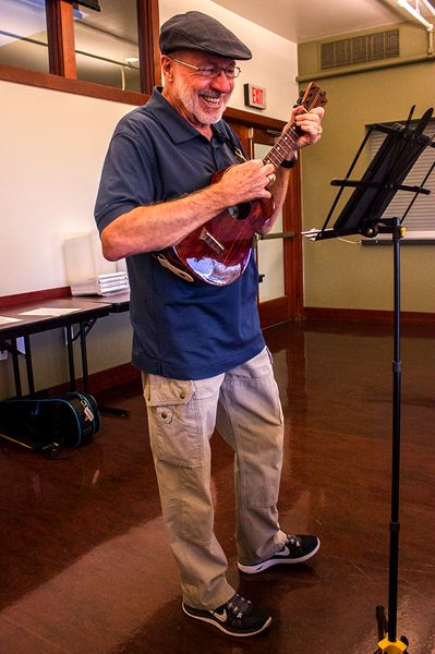 PAMPLIN MEDIA PHOTO: ANDREW BANTLY - Ron McCallister plays his ukulele as the leader of the West Linn ukulele jam session at the West Linn Adult Community Center.