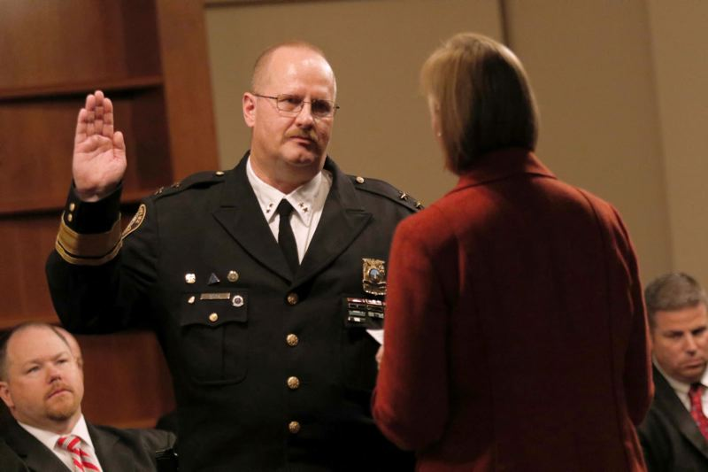 TRIBUNE FILE PHOTO - The city administrative probe of Chief Larry O'Dea, shown at his swearing-in ceremony, has notified his four top aides that they are now considered 'involved members,' suspected of violating city policies.