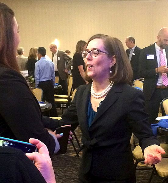 TRIBUNE PHOTO: PETER WONG - Gov. Kate Brown talks with Mari Watanabe, executive director of Partners in Diversity under Portland Business Alliance, after Westside Economic Alliance breakfast Wednesday, June 22, at Embassy Suites in Tigard.