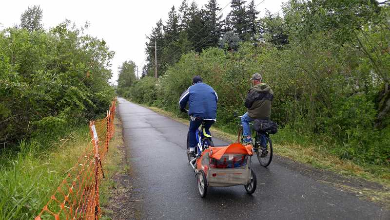 OUTLOOK PHOTO: CHRISTOPHER KEIZUR - A pair of cyclists brave the rain to enjoy the Springwater Corridor Trail, which is planned to receive a six-mile extension.