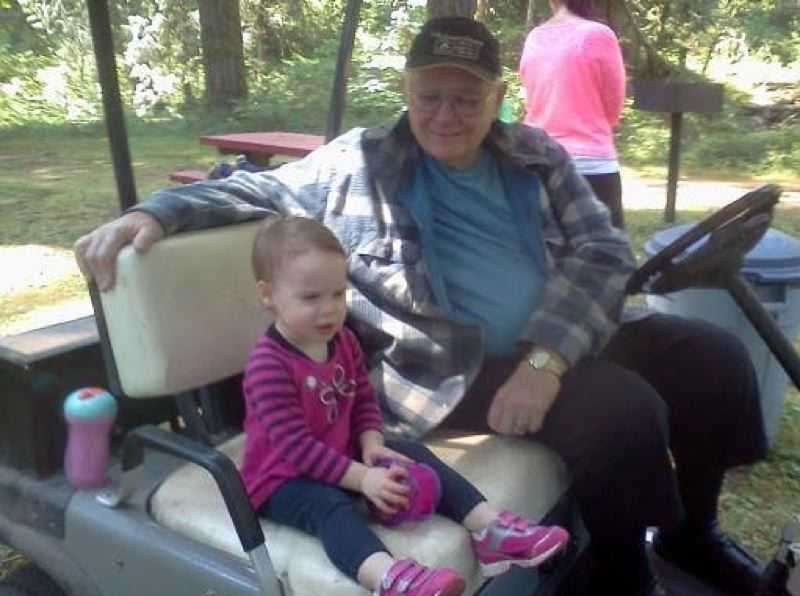 CONTRIBUTED PHOTO: LEROY GIBSON - Leroy Gibson, a camp host at Metzler Park, says one of the highlight of his job is meeting people, such as this young girl when she decided to join him in his golf cart.