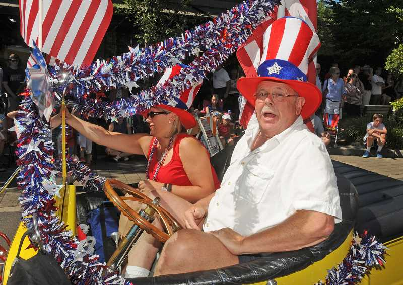REVIEW/TIDINGS FILE PHOTO: VERN UYETAKE - Greg Lang, a member of the Lake Oswego High School Class of '64, drove his 1923 Ford T-bucket in the Star Spangled Parade last year.