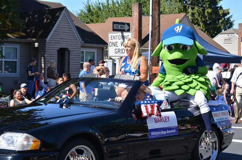 HILLSBORO TRIBUNE FILE PHOTOS - Barley, the official mascot of the Hillsboro Hops, rode atop a fancy car in last years Fourth of July parade.