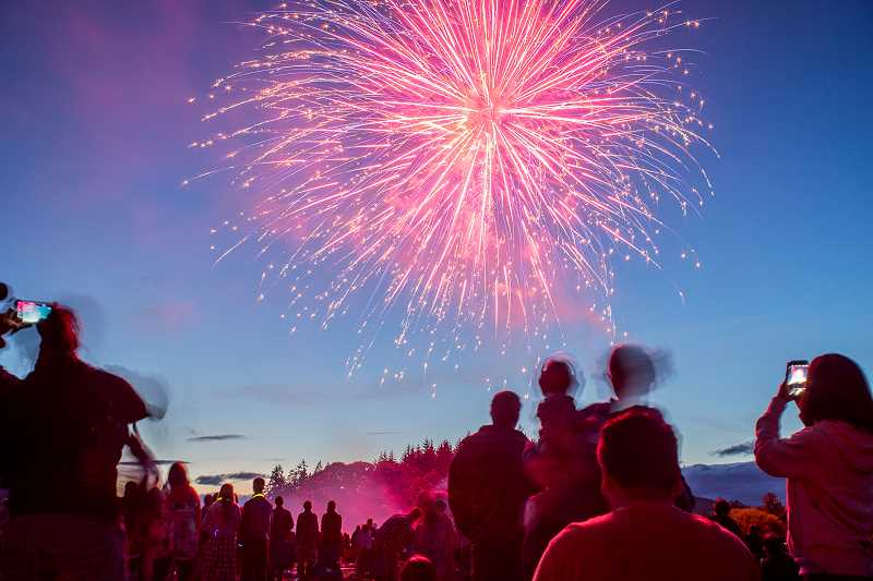 NEWS-TIMES PHOTO: TRAVIS LOOSE - Thousands of people gathered in the cool night air to watch fireworks light up the sky in Forest Grove Monday night, courtesy of the Western Washington County Firefighters Association.