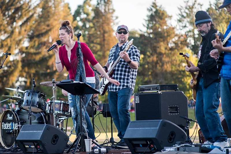 NEWS-TIMES PHOTO: CHASE ALLGOOD - Local band Fadedblue provided music for a few hours before the Forest Grove fireworks began.
