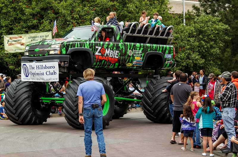 NEWS-TIMES PHOTO: TRAVIS LOOSE - At Hillsboros annual Fourth of July parade, the citys Optimist Club sponsored the entry of monster truck Zombie Tracker.