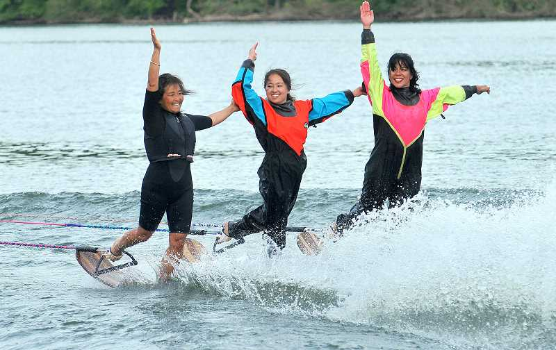 TIDINGS PHOTO: VERN UYETAKE - From left, Diane Cairns, Shaylyn Cairns and Ruthie White rotate 180 degrees on their skis.