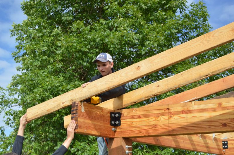 SPOTLIGHT PHOTO: NICOLE THILL - Richard Sass, a senior, works on a playground shelter at St. Helens High School during his independent carpentry class on June 2. Sass earned a first-place state award for his construction skills in April before qualifying to compete nationally.
