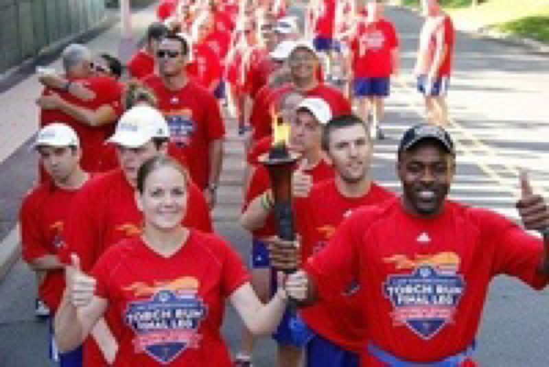SUBMITTED PHOTO - Smiling runners participate in the Torch Run.