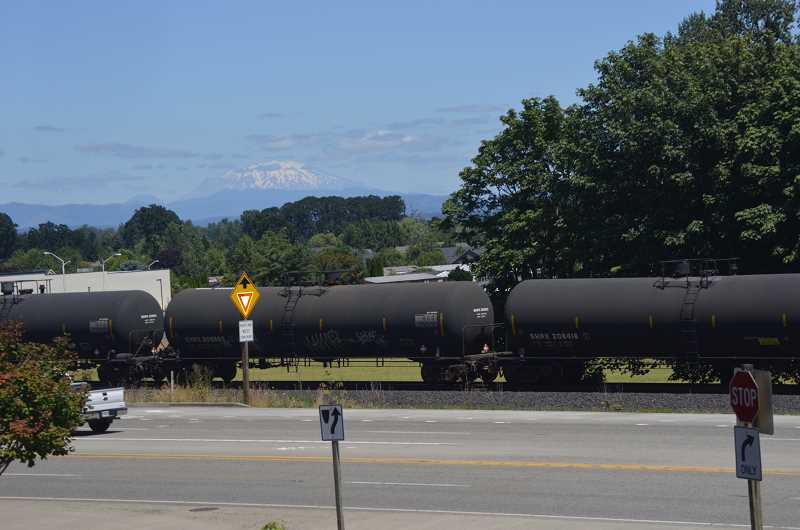 SPOTLIGHT FILE PHOTO - A freight train donning placards indicating the tankers transported ethanol passes through Scappoose Thursday, June 30.