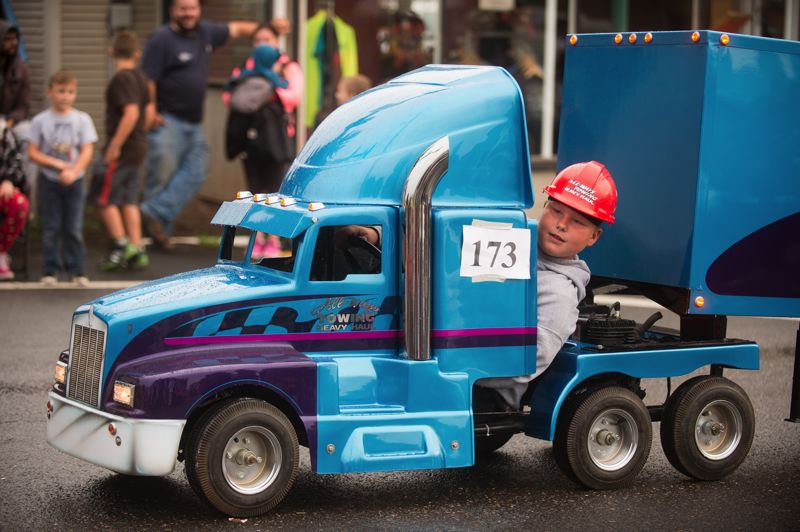 POST PHOTO: JOSH KULLA - Vehicles of all sizes, big and small, took part Thursday in the Sandy Mountain Festival Parade through downtown Sandy.