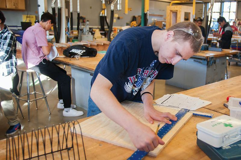OUTLOOK FILE PHOTO - A student learns construction skills at a wood shop class in Gresham.