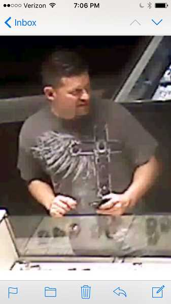 COURTESY OF TIGARD POLICE DEPARTMENT - A video surveillance camera caught this man, who police believed took a Rolex watch without paying for it.