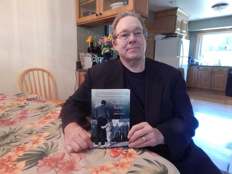 REVIEW, TIDINGS PHOTO: CLIFF NEWELL - Author Jack Estes displays his new novel A Soldiers Son, a book about a father fighting to prevent his son from repeating his own experience in the Vietnam War.