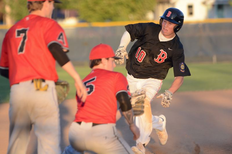 THE OUTLOOK: DAVID BALL - Eastsides Brayden Bafaro slides in safely ahead of Advanced Metals third baseman Dru Fitz during the Barbers 5-2 win to claim the Area 2 AAA legion title Wednesday night.