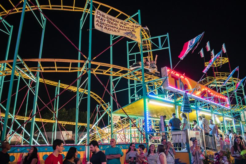 NEWS-TIMES/TRIBUNE FILE PHOTO - The Washington County Fair complete with midway rides and games, comes to the Washington County Fairgrounds Thursday through Sunday, July 28 through 31.