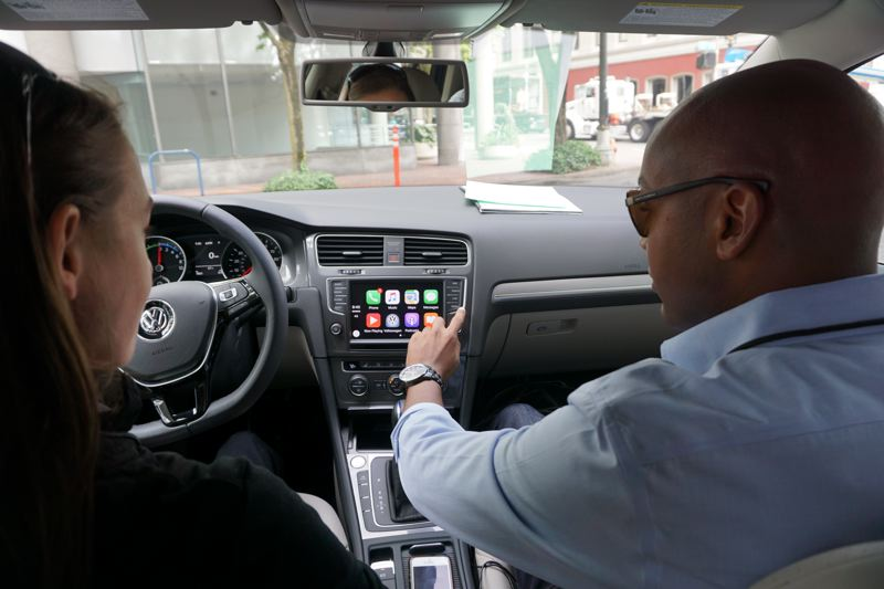 TRIBUNE PHOTO: JEFF ZURSCHMEIDE  - Some advanced technologies in today's cars are obvious, like the apps on the display screen of the 2017 Volkswagen e-Golf demonstrated by factory representative Darryl Harrison during Drive Revolution. Some safety systems only work when you need them, however.