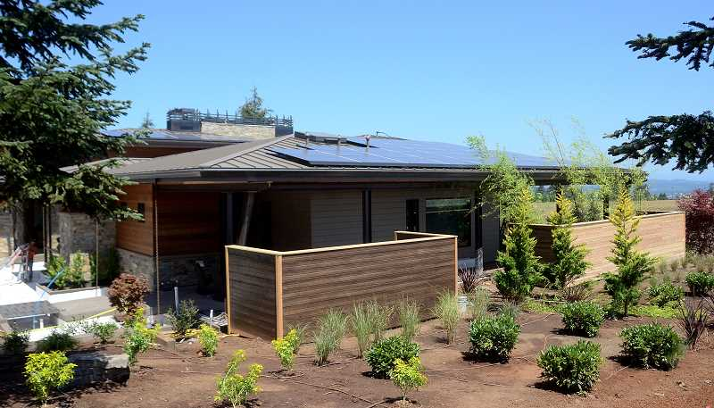 REVIEW PHOTO: VERN UYETAKE - Solar panels on the roof of 'Quintessence' are projected to provide 100 percent of the home's electricity, thus making it a 'net zero' property.