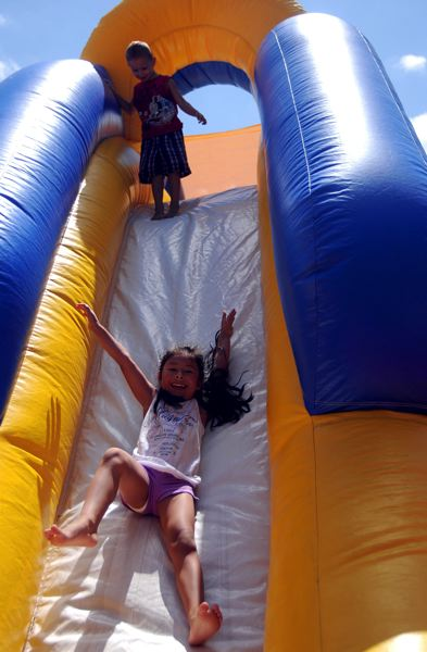 OUTLOOK PHOTO: JOSH KULLA - When two children are playing in a bounce house, they can track each other. But when you add a third or more to mix, that's when injuries happen.