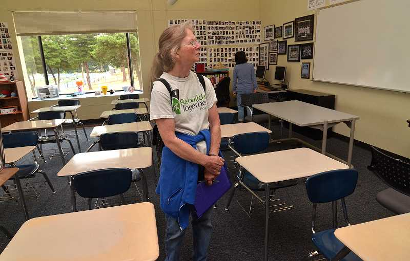 REVIEW PHOTO: VERN UYETAKE - Susan Corgan pauses to survey a Lakeridge High classroom during one of the first in a series of free tours of local schools.