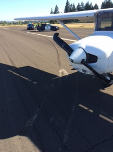 SCAPPOOSE FIRE DISTRICT PHOTO - A plane lands on the runway at Scappoose Airport with a hard landing Monday afternoon.