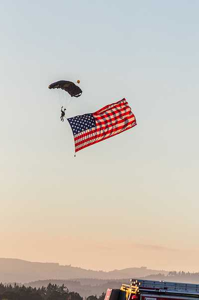 CHASE ALLGOOD - The U.S. Special Operations Command Parachute Team floats through the sunset Friday night.