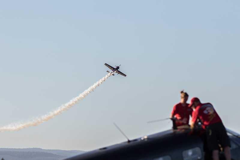 CHASE ALLGOOD - Renny Price buzzes his Sukhoi-29 past Matt Younkin's Beech 18 Friday night.