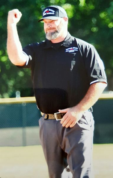 PHOTO CREDIT: ALLEN GOLLYHORN - Joel Dietz, 39, a District I Little League umpire-in-chief, of Scappoose, at last got his chance to officiate the Junior League Baseball West Regional Tournament at Propstra Stadium in Vancouver, Wash., after six years of volunteering.