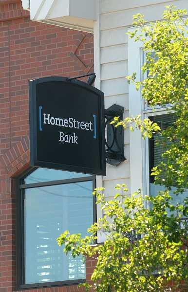 REVIEW PHOTO: VERN UYETAKE - New signs announce HomeStreet's arrival outside the bank's downtown Lake Oswego branch.