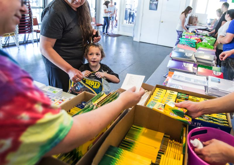TIMES PHOTO: JONATHAN HOUSE - Jacob Ulrich waits to collect school supplies during CPAH's annual backpack giveaway.