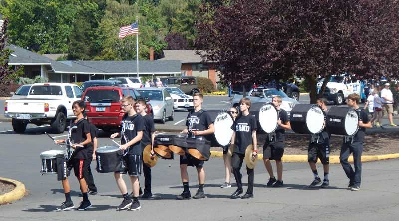 BARBARA SHERMAN - Members of the Tualatin High School Drum Line turned the 50th anniversary parade Aug. 13 into a festive event and drew residents out of their houses to view the parade as it moved through the city streets from the King City Clubhouse parking lot to King City Community Park.