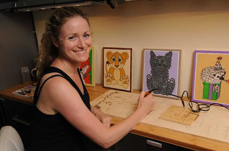 REVIEW PHOTO: VERN UYETAKE - Stephanie Sperring creates the designs for all of her products - from ducks and roosters to monkeys, giraffes, elephants and more - in a workshop in her Lake Oswego garage.