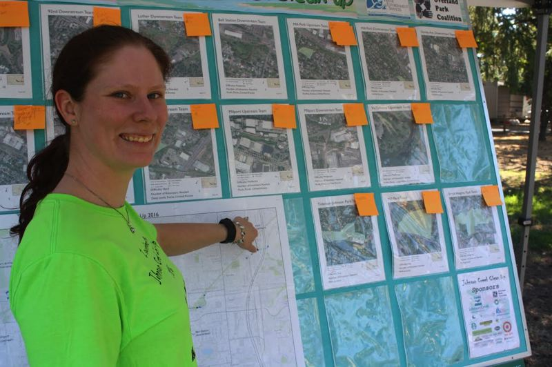 OUTLOOK PHOTO - Melanie McCandless points out clean-up sites around Johnson Creek.