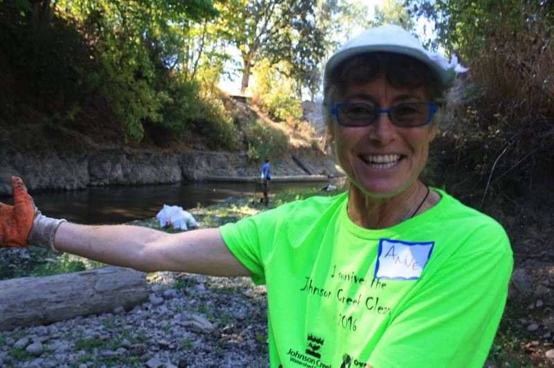 OUTLOOK PHOTO - Anne Mullan is a first-time volunteer during the 2016 Johnson Creek Clean Up.