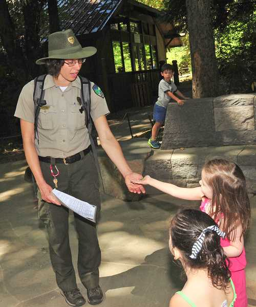 REVIEW PHOTO: VERN UYETAKE - Park Ranger Deb Hill chats with kids while giving a tour of Tryon Creek State Natural Area in August 2015.