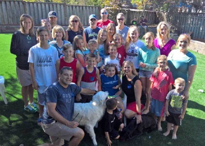 SUBMITTED PHOTO - The Farnum family is surrounded by friends and family at their Sept. 10 Make-A-Wish party in their turf-filled back yard; in front are dad bill, brother Alex, Ella and mom Beth, with brother Owen kneeling on the turf with dogs Rio (left) and Roxy.