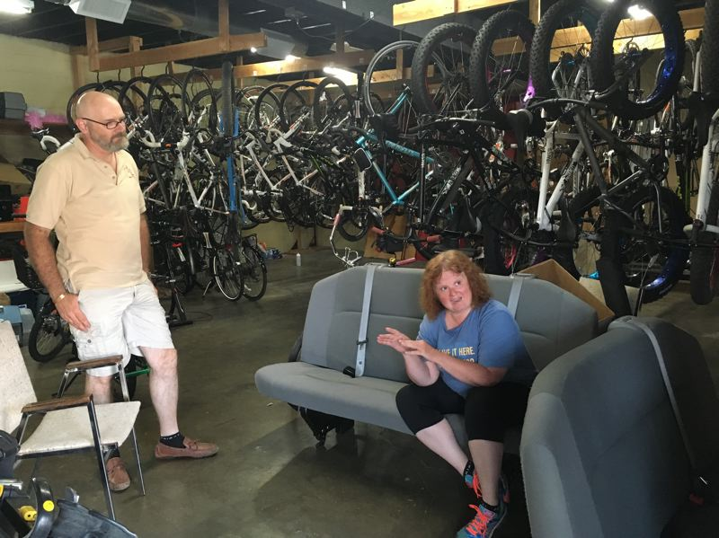PHOTO BY ANYI WONG-LIFTON - Shelley and Thom Batty are co-owners and founders of the Bike Concierge in their office behind First City Cycles on Main Street in Oregon City.