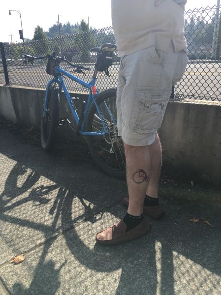 PHOTO BY ANYI WONG-LIFTON - Thom Batty's tattoo of the Bike Concierge logo, which was designed by a professional graphic designer and friend of the Battys.