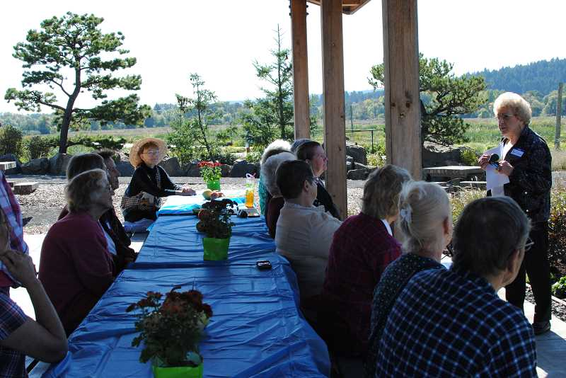 NEWS-TIMES PHOTO: STEPHANIE HAUGEN - Members of the club gathered together for some words and lunch at Fernhill Wetlands.
