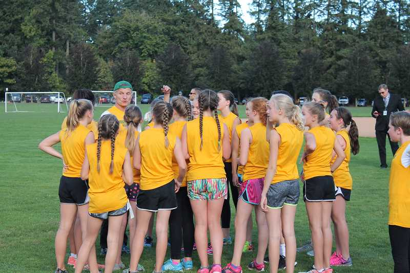 TIDINGS PHOTO: ANDREW KILSTROM - Rosemont Ridge Middle School cross-country coach Todd Jones preps his team before Tuesday's race Sept. 20.