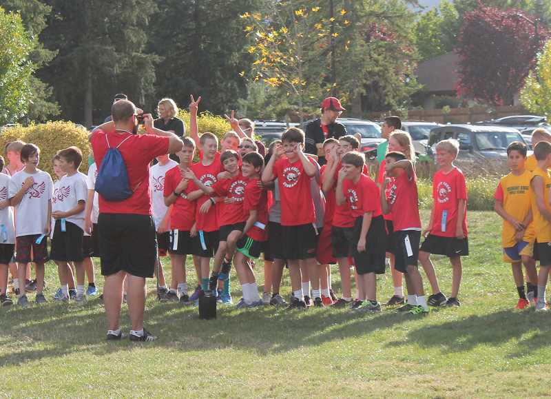 TIDINGS PHOTO: ANDREW KILSTROM - Athey Creek Middle School sixth-graders take a funny picture before their race Sept. 20.
