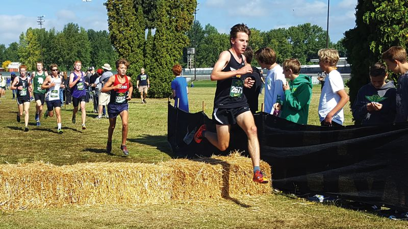 PHOTO CREDIT: SCAPPOOSE CROSS COUNTRY - Indians junior John Kavulich set a personal best of 15 minutes, 59.35 seconds in the Jim Danner Championships at the Nike Portland XC Invitational on Saturday, Sept. 24, at Portland Meadows Race Track.