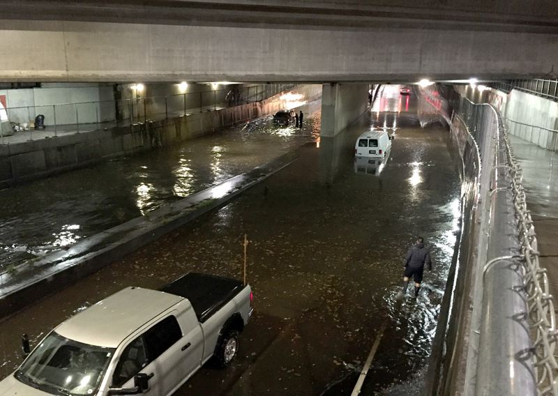 PAMPLIN MEDIA GROUP: DARRYL SWAN - Friday night's heavy rain flooded a section of Southeast Powell Boulevard at the 17th Avenue underpass. Several Portland streets were flooded by the storm that blew through the region at about 7 p.m.