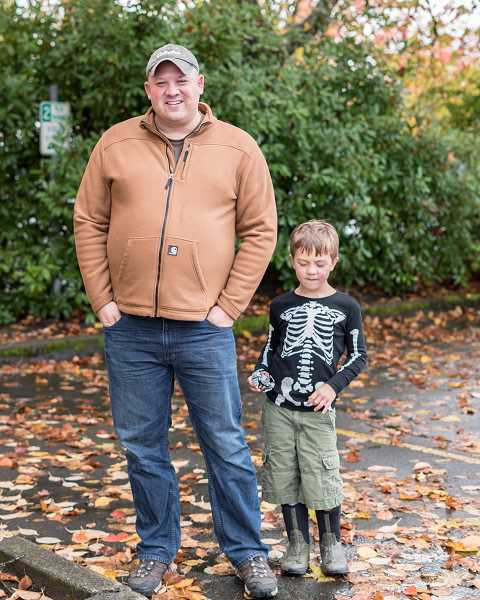 NEWS-TIMES/TRIBUNE PHOTO: CHASE ALLGOOD - Forest Grove Fire & Rescue's public information officer Dave Nemeyer with his son, Ben. Nemeyer has gained a loyal following on Instagram, where he posts  interesting historical facts and photos.