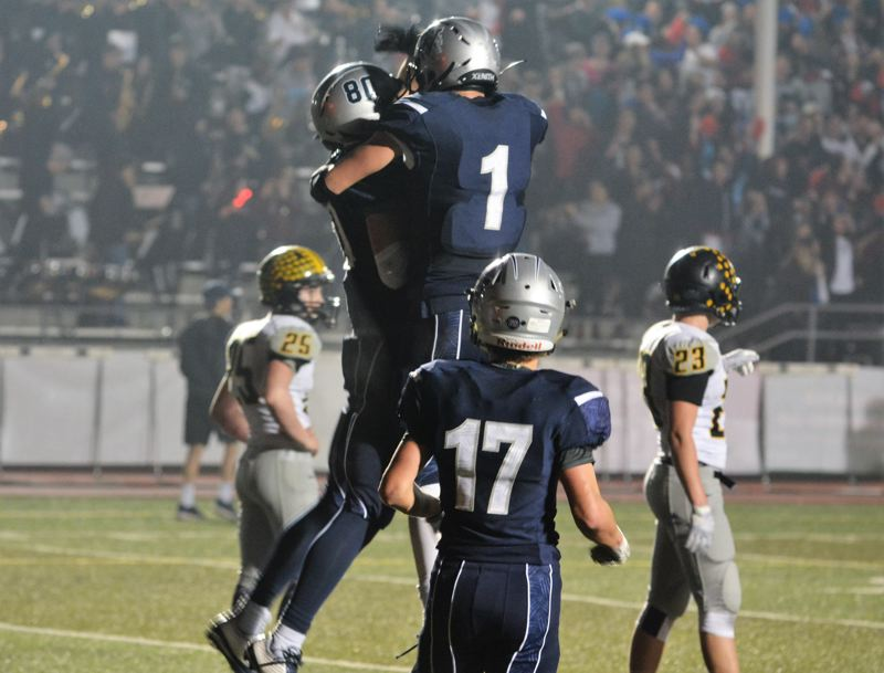 SPOTLIGHT PHOTO: JAKE MCNEAL - Wilsonville senior wide receivers Harrison Steiger (80) and Jonny Neville (1) celebrate Steiger's game-winning six-yard touchdown catch and 38-35 Class 5A state quarterfinal lead with 47.3 seconds left.