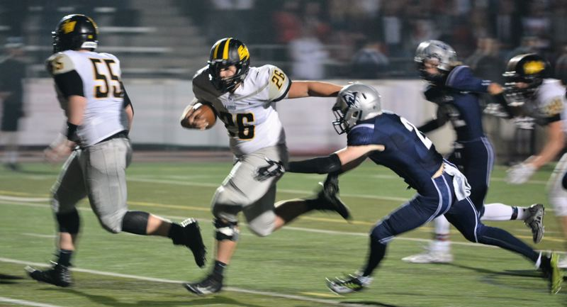 SPOTLIGHT PHOTO: JAKE MCNEAL - Tyler Rea (26) ran for three first-half Lions touchdowns.